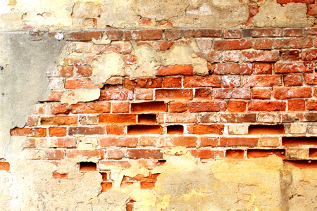 attic: Photo of a brightly colored old brick building wall