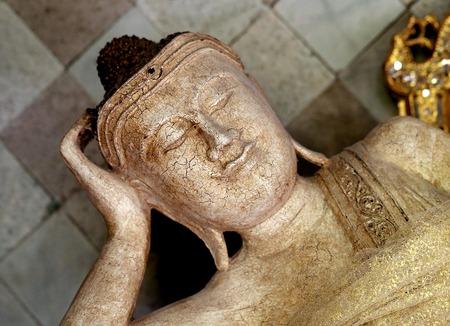 The statue of the sleeping Buddha photograph closeup