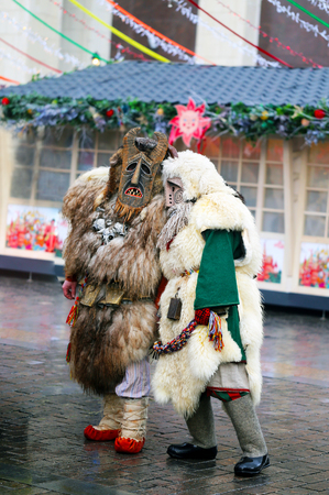 People in national Russian folk costumes in masks of ancient idols. Maslenitsa in Moscow on red square