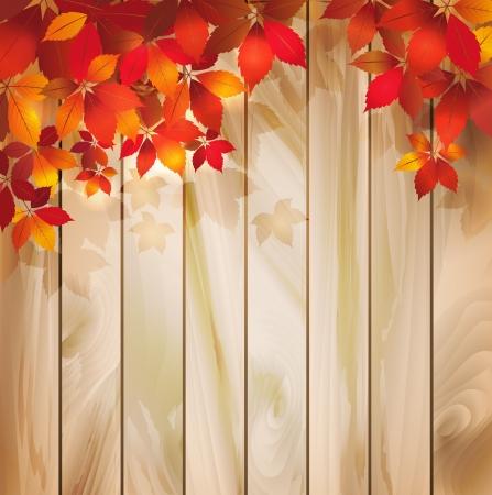 Fondo del oto�o con las hojas en una textura de madera