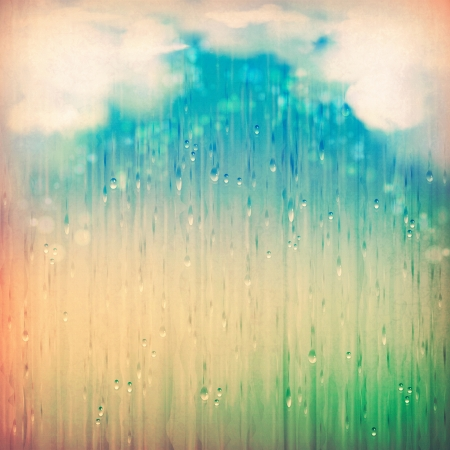 Colorful rain. Vintage abstract grange rainy landscape background. Clouds, water, rain drops, blurred lights on the textured old paper in retro style. Natural sky artistic wallpaper design Stock Photo