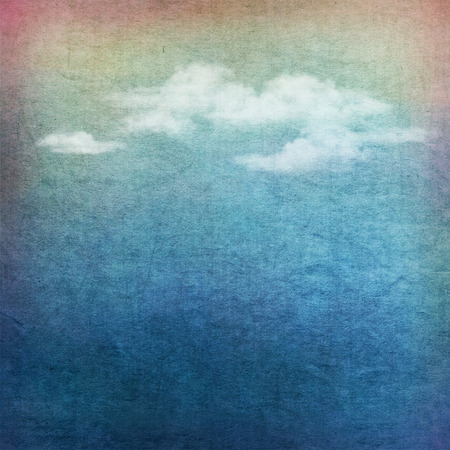 Vintage sky background with white clouds on fabric texture Foto de archivo
