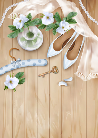 lay: Wedding floral top view background with white flowers, shoes, silk scarf, pearl beads on a wooden table