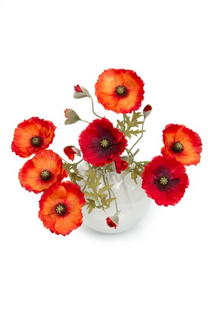 The image of a bouquet of artificial poppies in a vase, isolated, on a white background.
