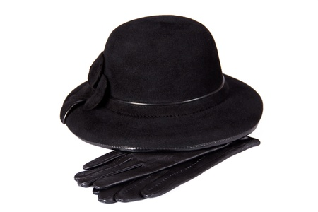 Images of a female hat lying on the leather gloves, isolated, on a white background
