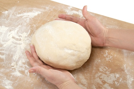 Beautiful womens hands knead the dough for baking Stock Photo
