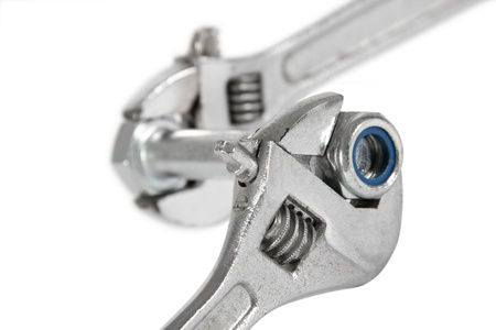 The image of the wrench which is turning off a nut from a bolt, isolated, on a white background Stock Photo - 9173815