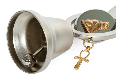 Bottle opener in the form of a bell, isolated on white background photo