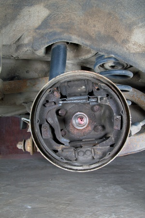 Old brake pads and cylinder brake drum photo