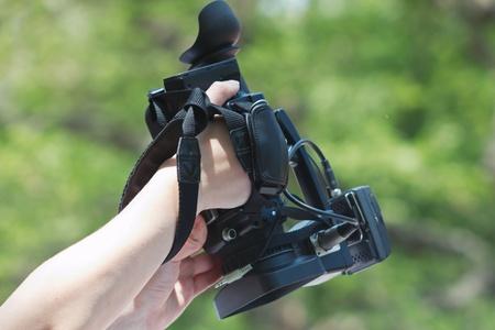 Operator holding a TV camera