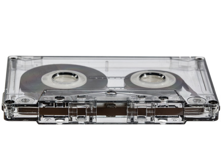 lose up: Сlose up of vintage audio cassette, isolated on white background