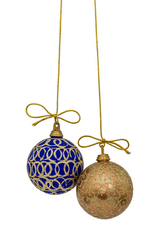 blue and white: Beautiful Christmas balls are suspended on a gold thread, isolated on white background
