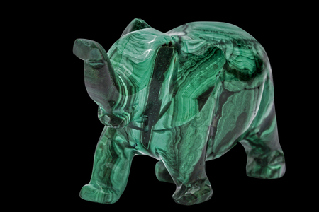Elephant figurine from malachite, isolated on black background, with clipping path