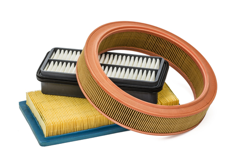 Car filters close-up, auto spare part, isolated on white background
