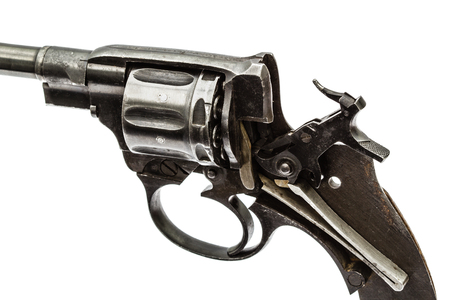 barrel pistol: Disassembled revolver, pistol mechanism with the hammer cocked, isolated on white background