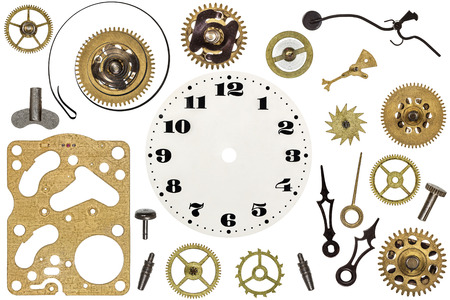 Spare parts for clock. Metal gears, cogwheels, clock face and other details Stock Photo