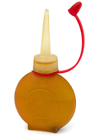anoint: Old bottle of lubricating machine oil, isolated on white background