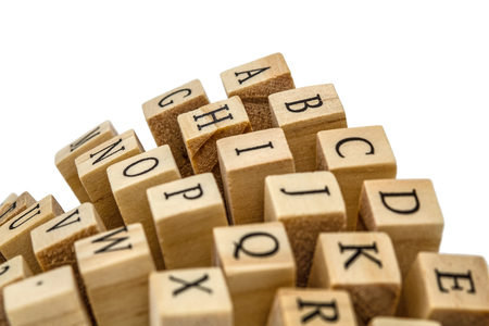 key words art: Letters of the English alphabet on the ends of wooden bars, isolated on white background Stock Photo
