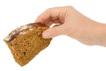 comiendo pan: Female hand holds a slice of bread, isolated on white background