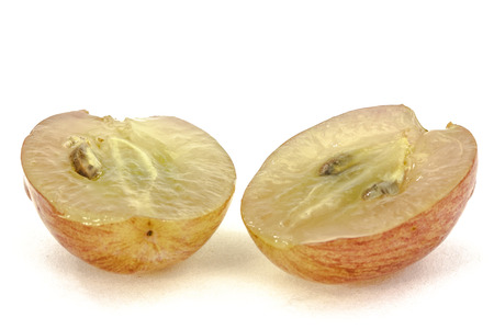 bisected: Half of the fruit of the grapes close-up, isolated on white background