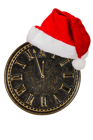 reloj de pendulo: Clock face and cap of Santa Claus, isolated on white background