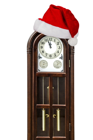 Grandfather clock and cap of Santa Claus, isolated on white background