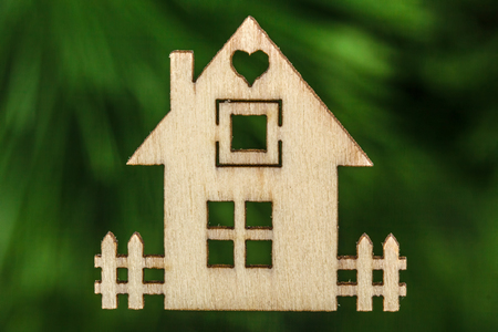 abstracted: Wooden house facade on abstracted green background Stock Photo