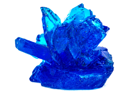 Blue crystals of vitriol, Copper sulfate, isolated on white background Stock Photo