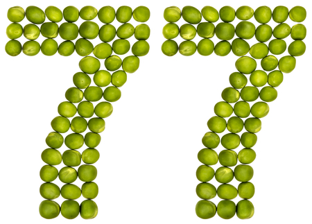 Arabic numeral 77, seventy seven, from green peas, isolated on white background