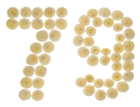 computation: Arabic numeral 79, seventy nine, from cream flowers of chrysanthemum, isolated on white background