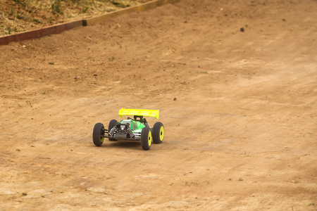 radio activity: Radio controlled car model in race on dirt track