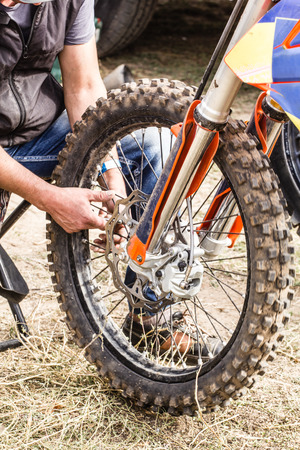 motobike: Repair of a sports motorcycle wheel close-up Stock Photo