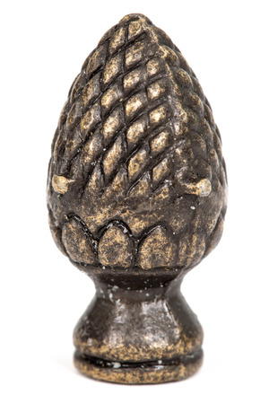 Decorative element in the form of pine cone from bronze, isolated on white background Stock fotó