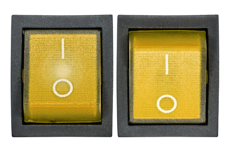Yellow power switch, isolated on white background, with clipping path