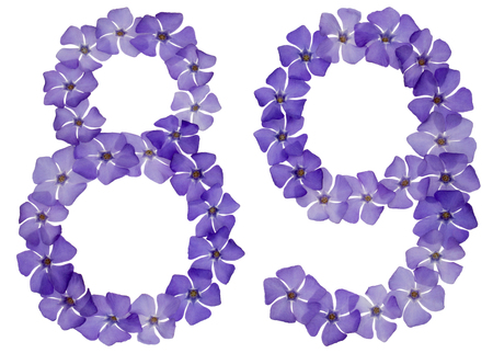 Numeral 89, eighty nine, from natural blue flowers of periwinkle, isolated on white background