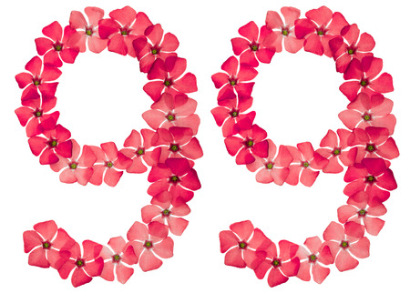 Numeral 99, ninety nine, from natural red flowers of periwinkle, isolated on white background