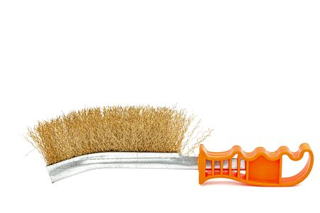 Brass wire brush with handle from orange plastic for cleaning and polishing hard or metal equipment, isolated on white background Archivio Fotografico