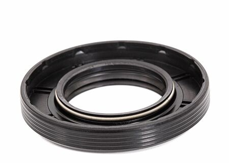 Oil seal for machine repair, isolated on white background Stock Photo