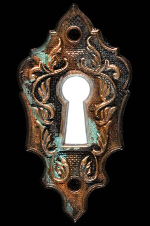 Bright light in the keyhole, decorative design element, isolated on black background Banque d'images