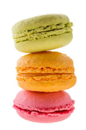 Three colorful macarons isolated on white background