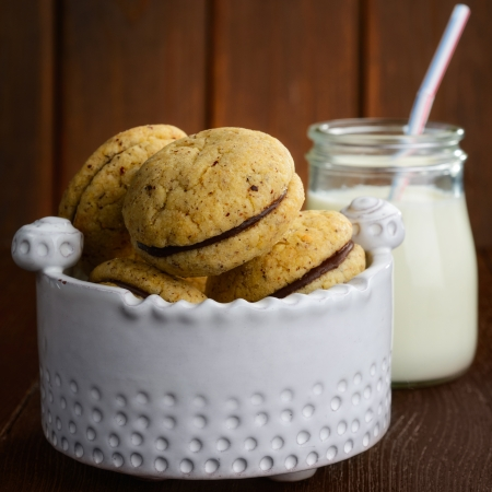 cookies and glass milk on wood table photo