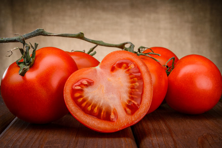 Close-up of fresh, ripe tomatoes on wood