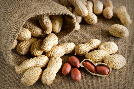 Peeled peanut on well peanuts in background photo