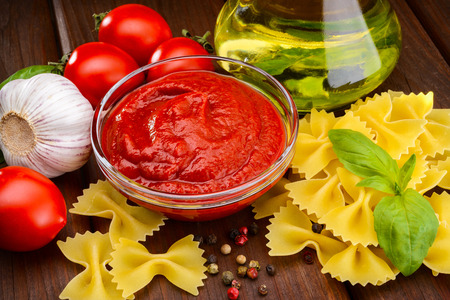 traditional tomato sauce in a glass sauceboat photo