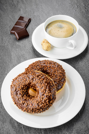 breakfast with coffee and donuts on gray  photo