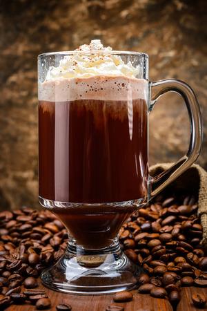 irish christmas: Irish coffee on wooden table among coffee beans