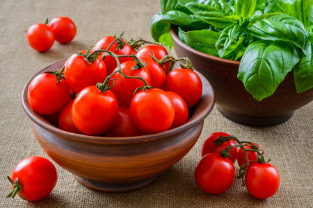 Fresh grape tomatoes with basil photo