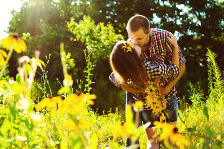 love kiss: Young kissing happy couple in love Stock Photo