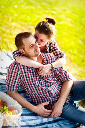 happy young couple enjoying picnic. Toned image photo