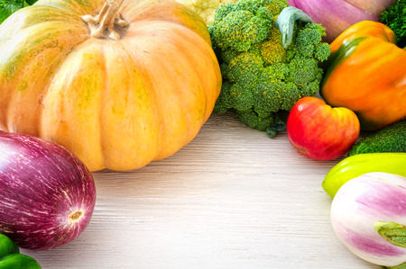 Fresh vegetables on wooden table photo